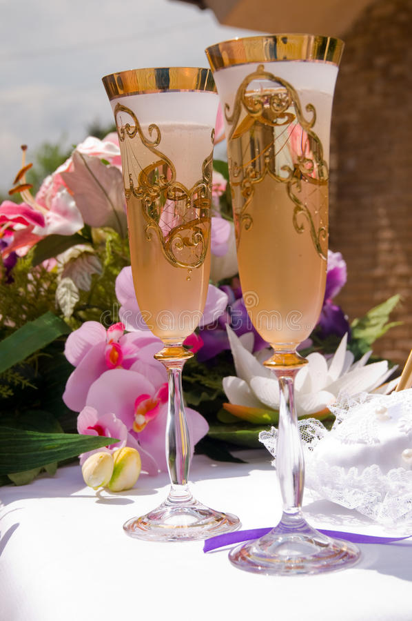 Wedding champagne. Glasses on the table royalty free stock photos