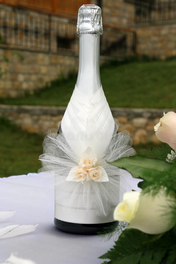 Wedding champagne. Decorated with flowers royalty free stock photos