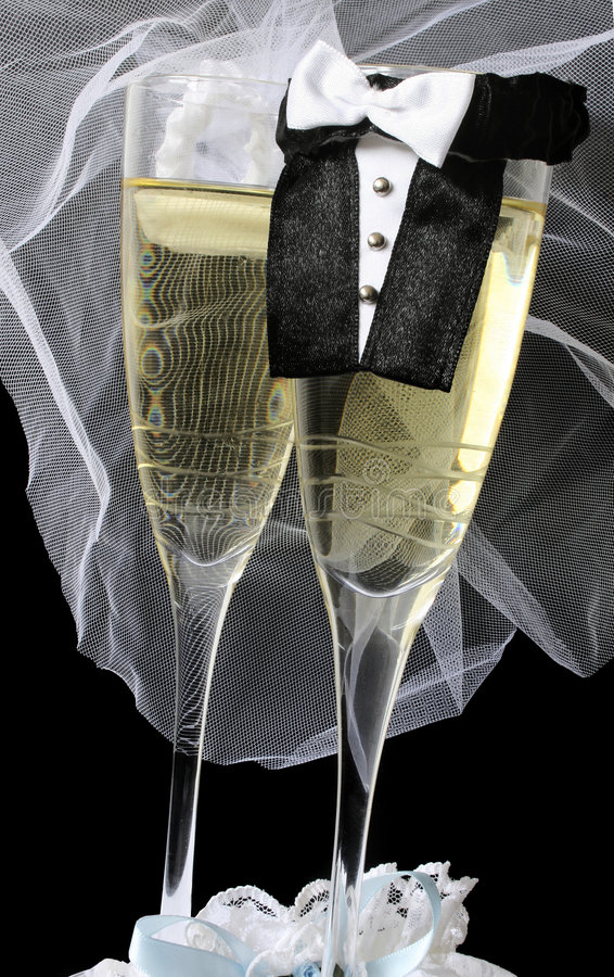 Wedding Champagne. Two champagne flutes dressed up as bride and groom royalty free stock image
