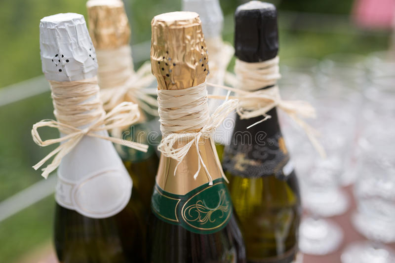 Wedding champagne. Designer wedding champagne at the Buffet table waiting for guests royalty free stock photography