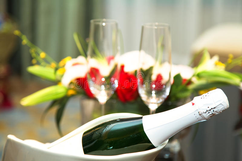 Wedding champagne. With glass and bouquet in studio shoot royalty free stock photo