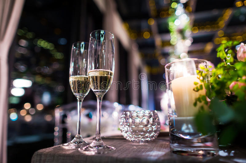 Wedding Champagne glasses. At indoor wedding royalty free stock photos