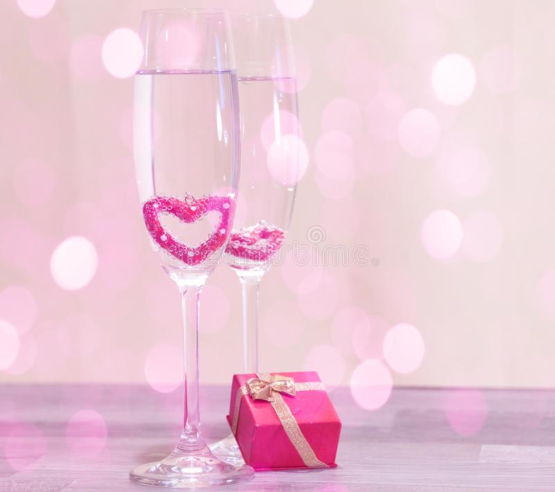Wedding champagne glasses, romantic heart background royalty free stock image