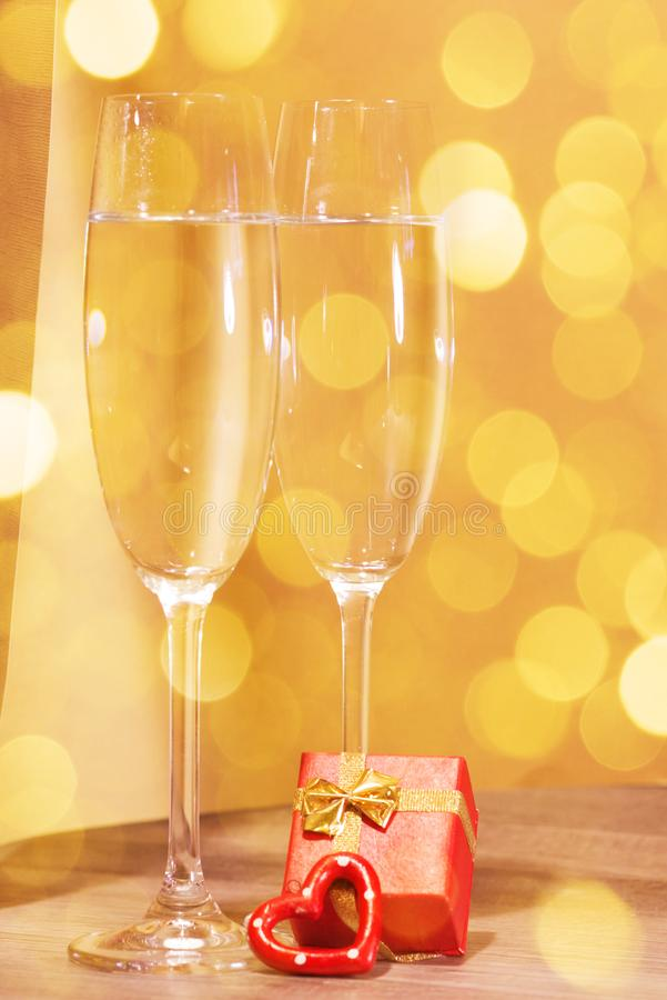 Wedding champagne glasses, romantic heart background royalty free stock photography