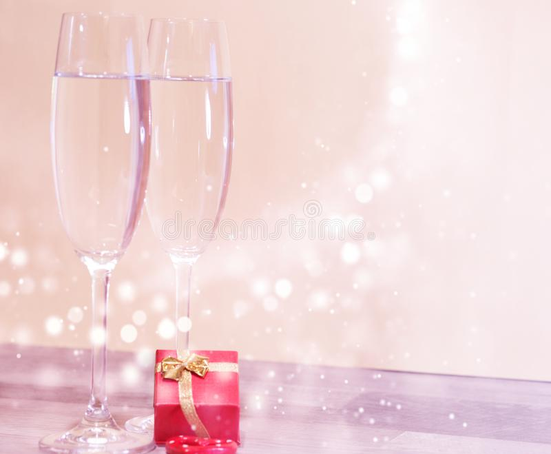 Wedding champagne glasses, romantic heart background stock photography
