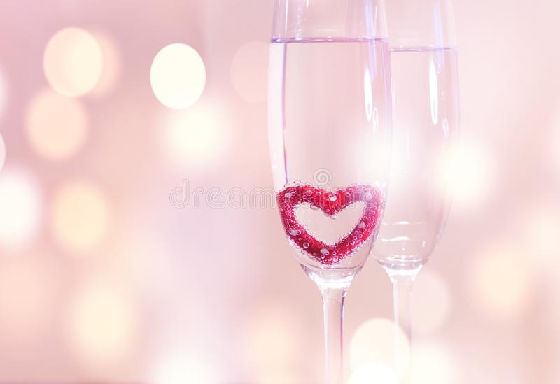 Wedding champagne glasses, romantic heart background royalty free stock photo