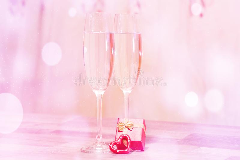 Wedding champagne glasses, romantic heart background stock image