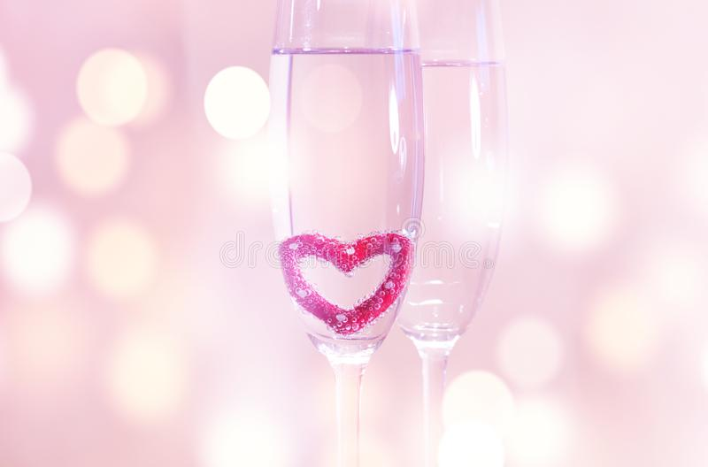 Wedding champagne glasses, romantic heart background royalty free stock images