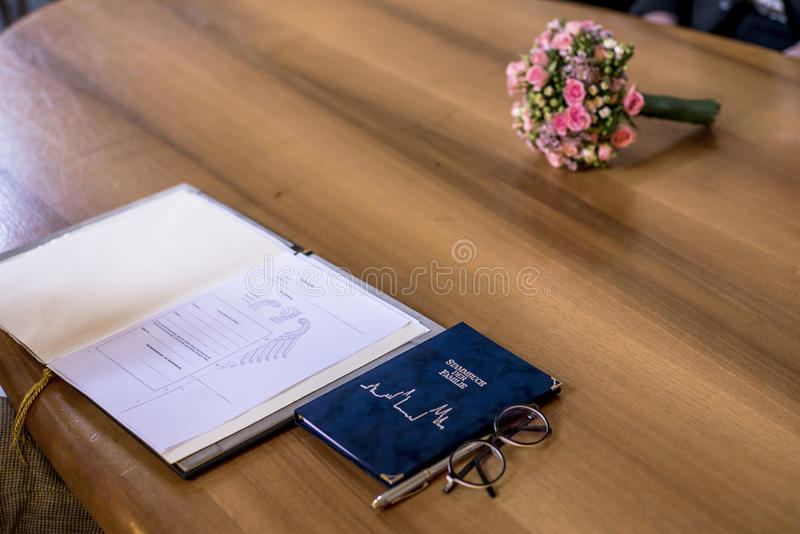 Wedding civil german marriage Register with Pen and Bouquet of Fresh Beautiful Flowers on Wooden Table. Wedding civil german marriage Register with Pen, and royalty free stock images