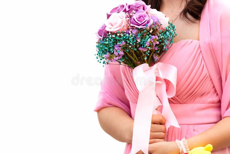 Wedding concept. Bridesmaid holding wedding bouquet isolated on white background. Free space stock image