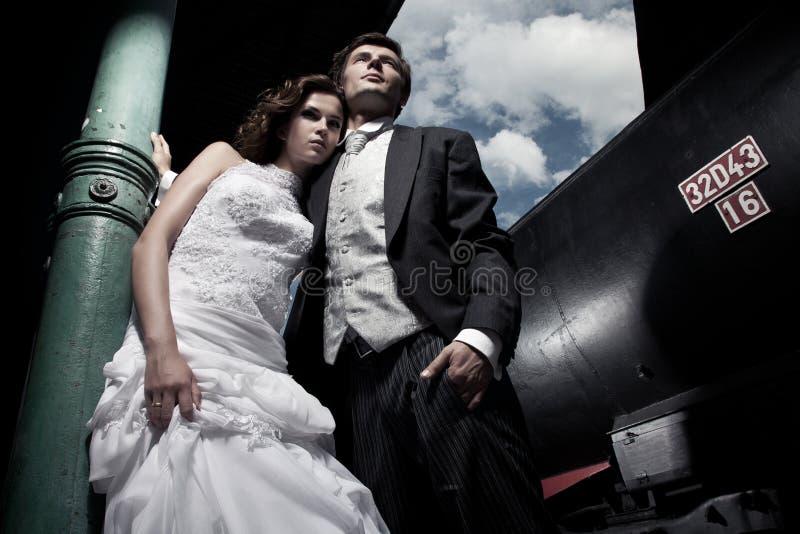 Wedding couple. Fine art photo of an attractive wedding couple stock photo