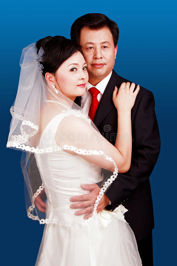 Wedding couple. Portrait on blue background royalty free stock image