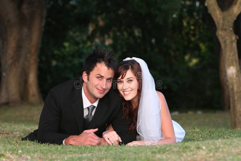 Wedding Couple. Beautiful happy smiling wedding couple on their big day stock images
