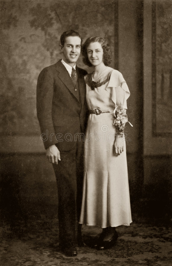 Wedding Couple. 1930 antique photograph of young couple on wedding day. Sepia-toned desaturated color file. Original photograph taken December 24th, 1930 stock image