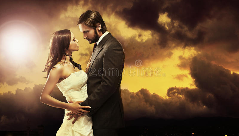 Wedding couple. Fine art photo of an attractive wedding couple royalty free stock photos