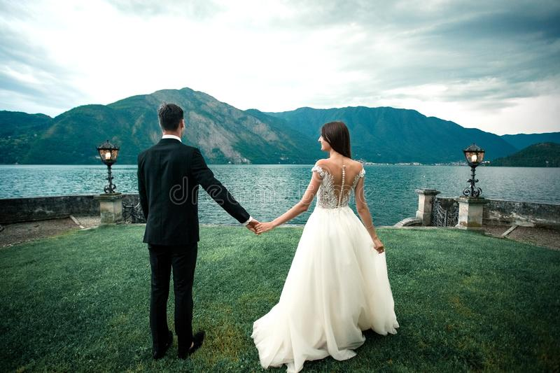 Wedding couple against the background of the lake and mountains royalty free stock images