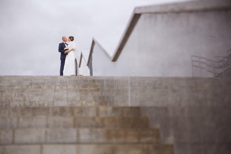 Wedding couple away stock images