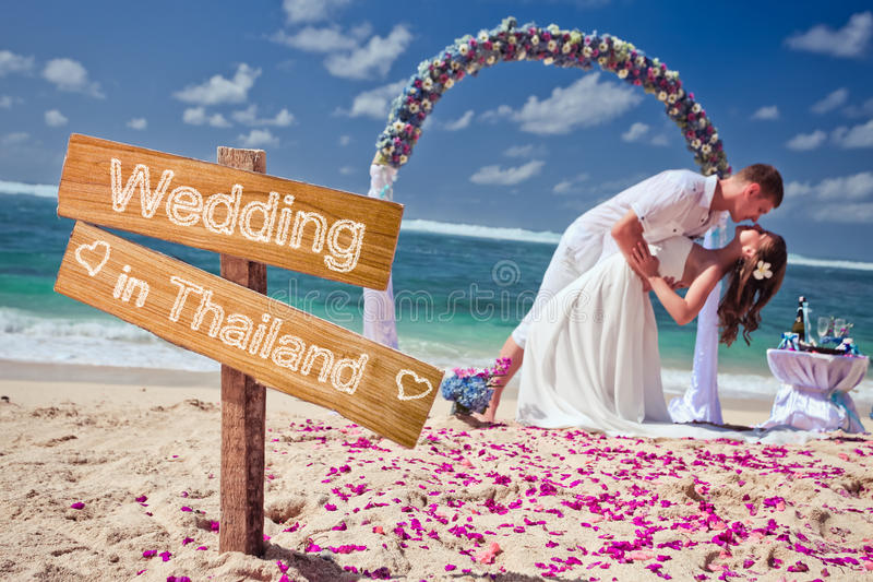 Wedding couple at the beach. Wedding couple just married near the beach at Thailand with copy space for text stock image