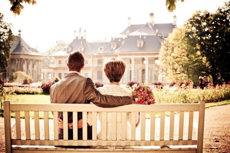 Wedding couple on bench stock photos