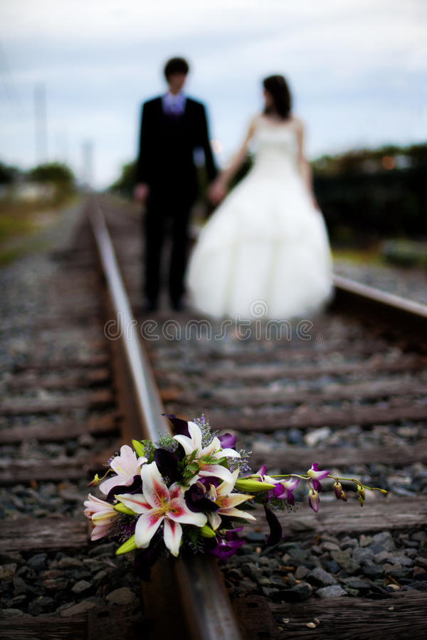 Wedding couple and bouquet stock images