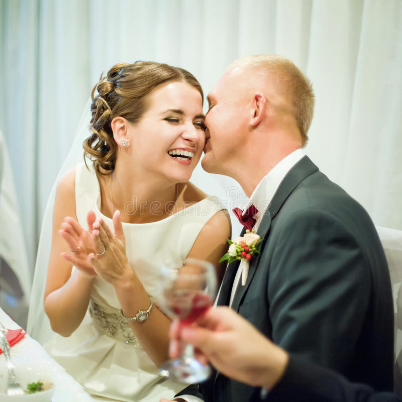 Wedding couple. Bridal couple laughs at a banquet