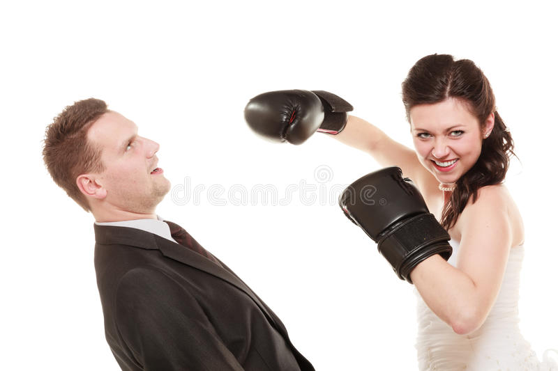 Wedding couple. Bride boxing groom. Conflict. royalty free stock image