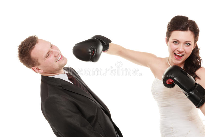Wedding couple. Bride boxing groom. Conflict. stock image