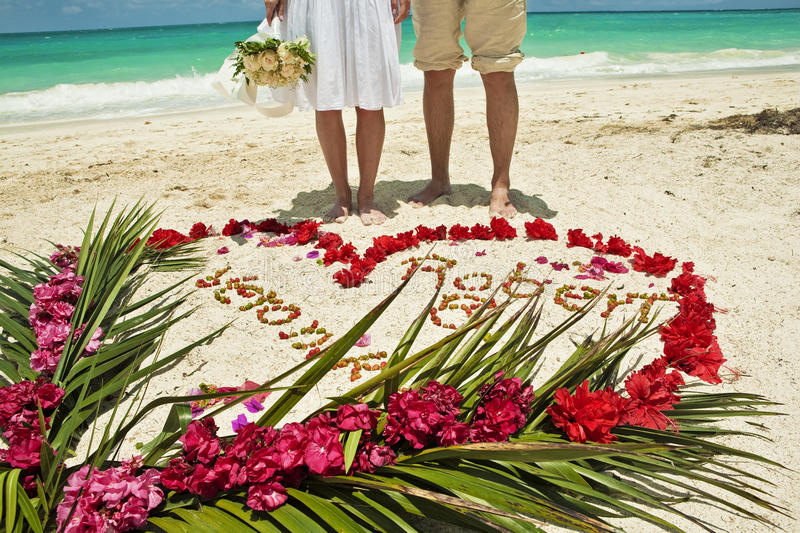 Wedding couple in Caribbean beach stock images