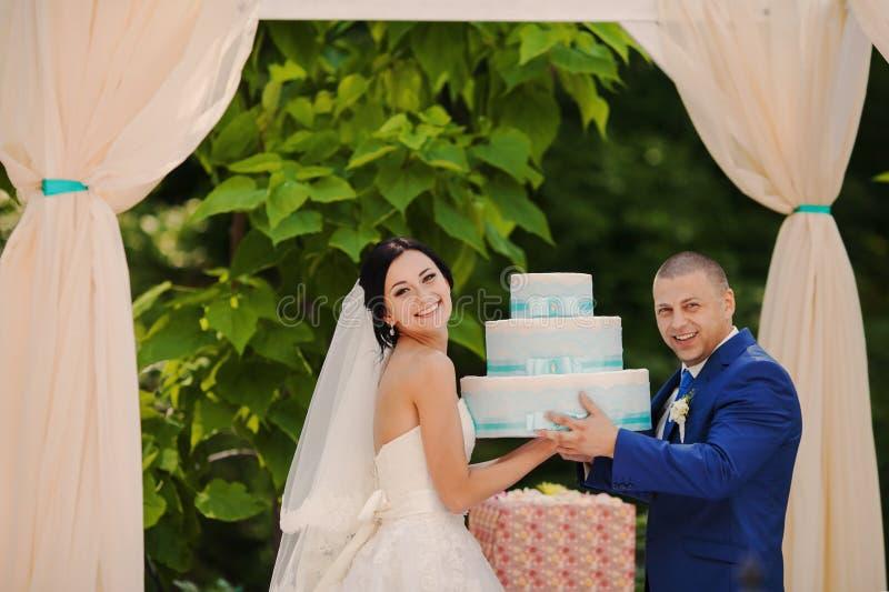 Wedding couple couple holding gifts royalty free stock photos