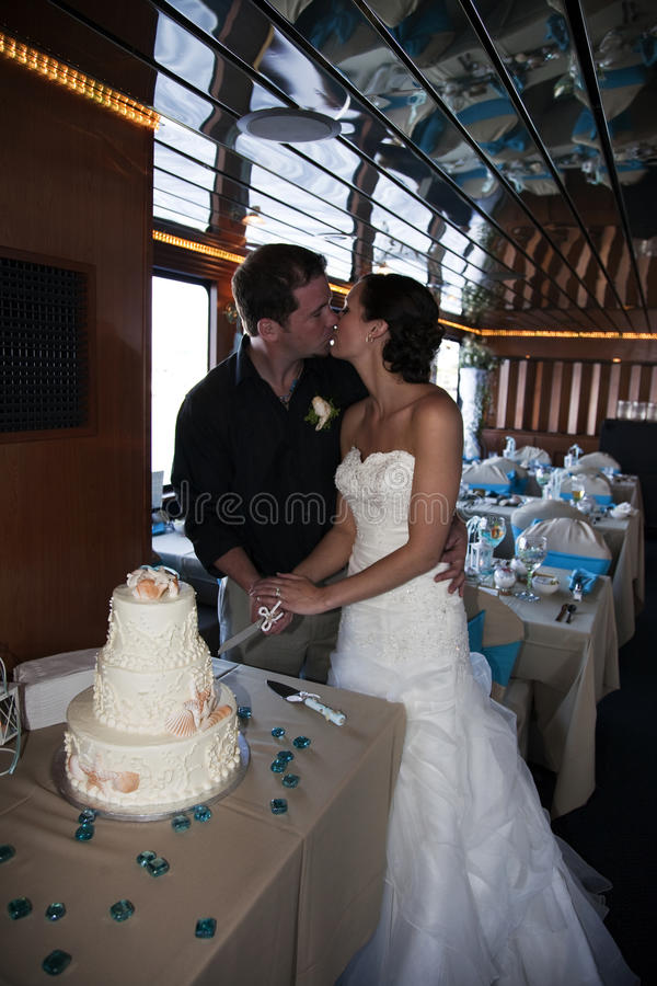 Wedding couple cutting cake royalty free stock photo