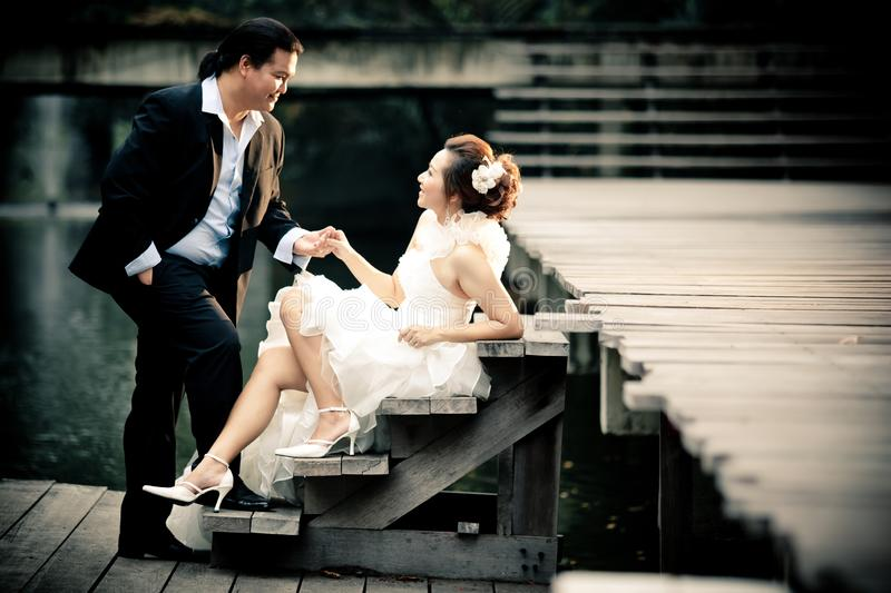 Wedding couple enjoying romantic moments outsides on a summer. Happy bride and groom on their wedding. stock image
