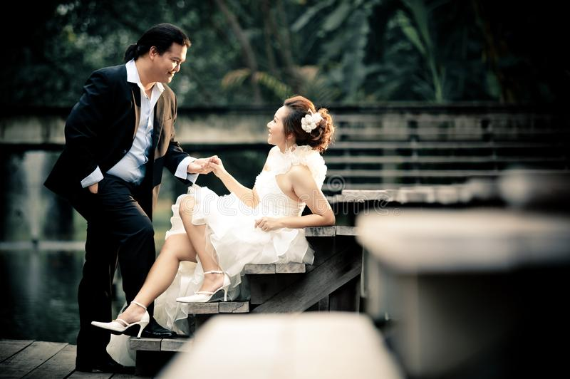 Wedding couple enjoying romantic moments outsides on a summer. Happy bride and groom on their wedding. royalty free stock images