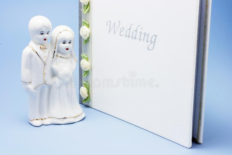 Wedding Couple Figurine and Photo Album stock images