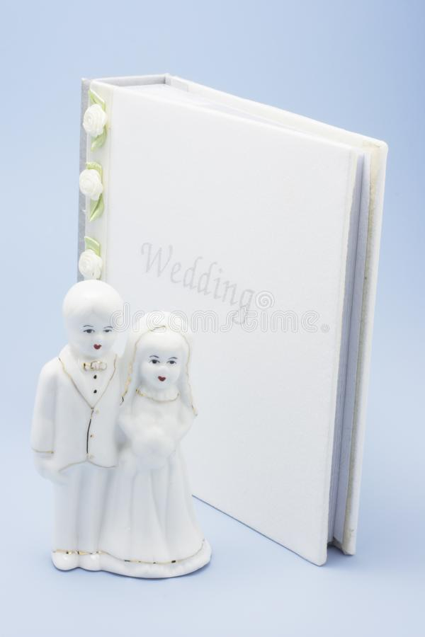 Wedding Couple Figurine and Photo Album stock photography