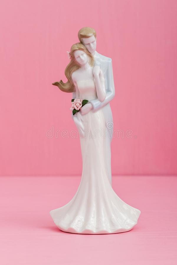 Wedding Couple Figurine on Pink Background stock images