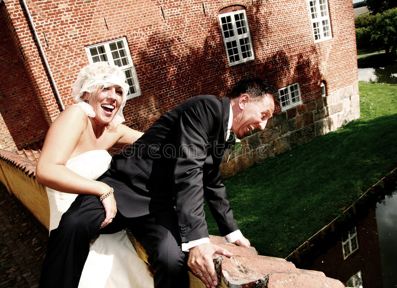 Wedding couple fun stock photography