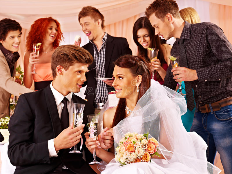 Wedding couple and guests drinking champagne. Happy wedding couple and guests drinking champagne royalty free stock photos