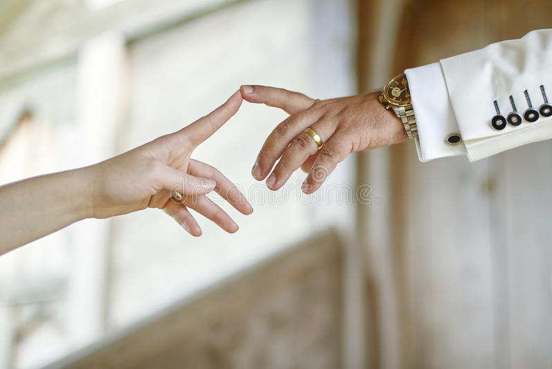 Wedding couple hands touching the index fingers. Wedding couple hands touching index fingers royalty free stock images