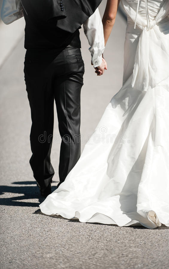 Download Wedding Couple Holding Hands Stock Photo - Image: 73294680