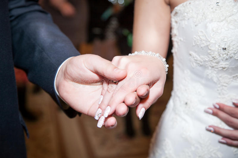 Wedding couple holding hands, happy groom and bride, soft touch royalty free stock photo