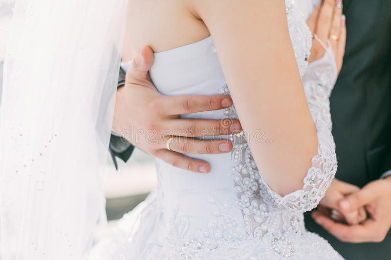 Wedding couple holding hands and hugging royalty free stock image