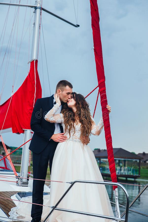Wedding couple is hugging on a yacht. Beauty bride with groom stock images