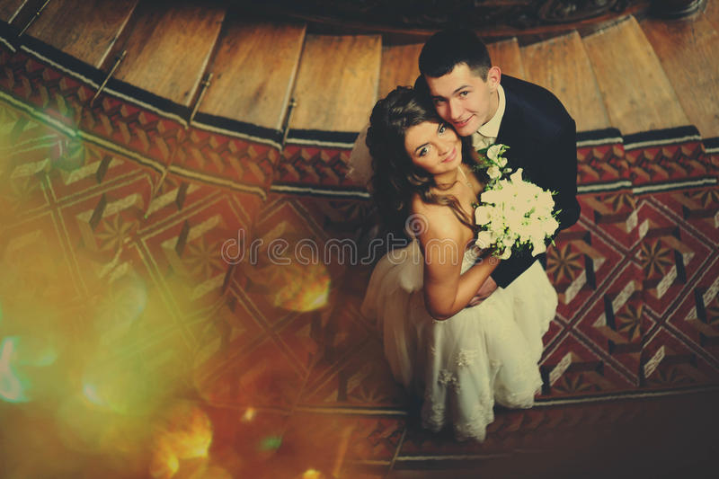 Wedding couple hugs each other and looks up royalty free stock image