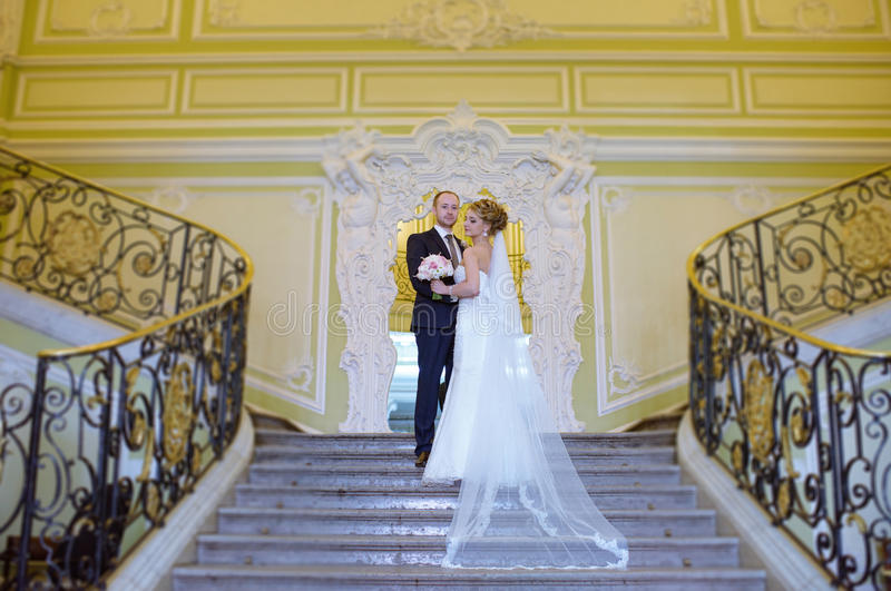 Wedding couple indoors is hugging each other royalty free stock images