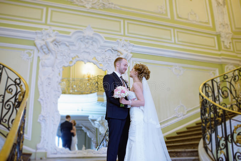 Wedding couple indoors is hugging each other royalty free stock photo