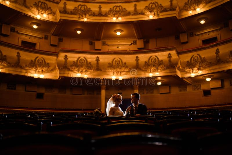 Wedding couple indoors is hugging each other. Wedding couple in drama theater.the bride and groom, love, dress, beautiful, female, young, woman, white, romantic royalty free stock images