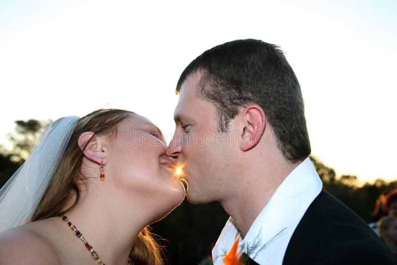 Wedding Couple kissing stock photos