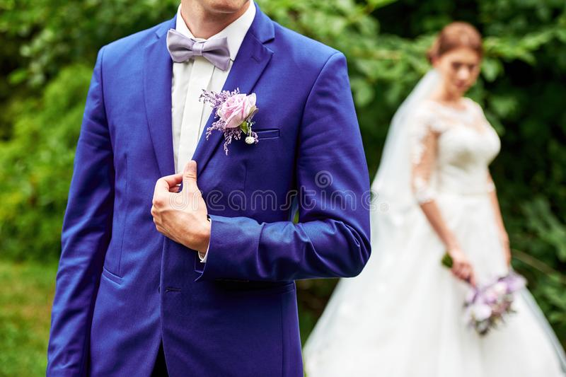 Wedding couple in love, newlyweds, copy space. Happy bride and groom walking in garden outdoors royalty free stock photo