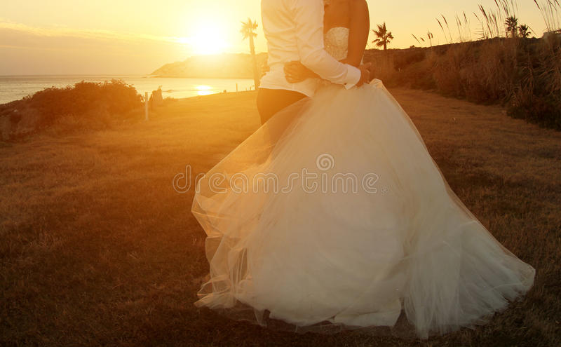 Wedding Couple. Lovely wedding couple embracing at the beach royalty free stock photos