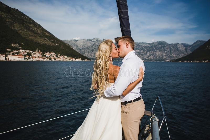 Wedding couple on the luxury yacht sailing down the sea, Montenegro royalty free stock image